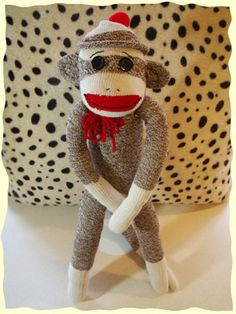 Contemplating the minimalist lifestyle I pondered about gifts for children, what to give etc. How about your mans used (and laundered) socks, recycled and crafted into an adorable sock monkey. Mama G' gifted this to my son who is almost 2, He loves it, surprisingly so does my other son who is 7. He thinks that a monkey made out of socks is pretty stinkin cool, hehe no pun intended !