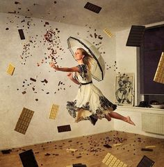 The girl with the white parasol in the hands of flies in the room catching in…