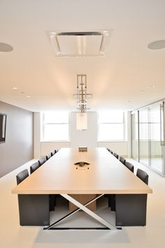 AC Executive X-Legs conference tables are intended for large boardroom applications. The tables have X-Legs and wire management shrouds below. Wood Power access grommets are available in one, two, or all sections.