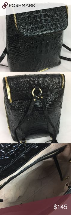 """Brahmin Melbourne Collection Darcy Croco Backpack Condition: Exterior: Grade A (missing top handle - See photos.) Interior: Grade A. Hardware: Grade A.   From the Melbourne Collection by Brahmin, the Darcy backpack features: croco embossed leather flap with zipper closure side zipper function interior zip pocket, organizer pocket, pen pocket, and key clip exterior back cell phone pocket footed bottom approx. 12(H) x 10(W) x 4.5(D)""""   Thank you for your interest! No Trades. Brahmin Bags…"""