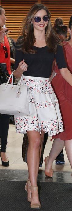 Miranda Kerr in Christian Dior, a Prada bag, Alexander Wang 'Liya' heels, Miu Miu sunglasses and Bulgari jewels in Sydney.