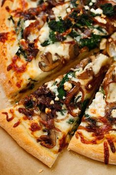 A caramelized onion feta spinach pizza with white sauce. Balsamic caramelized onions, garlic, sautéed spinach and feta cheese make this a gourmet pizza!