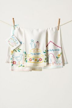 Storybook Romance Dishtowels from Anthropologie $42  Embroidered linens with cute little birds falling in love