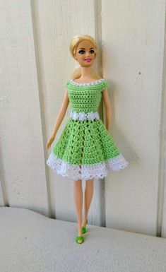 Best 11 Crochet Dolls Design Handmade dress for Barbie doll by my own design. Crocheted dress made of light green cotton yarn in combination with a white cotton yarn. Fastened at the back by two snap buttons. Doll and shoes is NOT included. Crochet Doll Dress, Crochet Barbie Clothes, Doll Clothes Barbie, Barbie Doll, Crochet Dresses, Barbie Clothes Patterns, Clothing Patterns, Crochet Barbie Patterns, Dress Patterns
