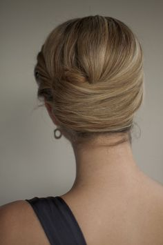 """French roll with a twist - """"A twist on the classic French roll hairstyle, twisting in from the front and twisting up at the side."""""""