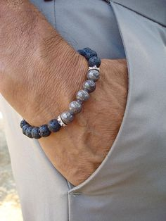 Mens Spiritual Protection and Serenity Bracelet with a design of semi precious Gray Jade 8mm with a deep and stunning color, the Jade array has Bali Caps on each side, Black lava 8mm and a black wood cube. A classy combination of colors for the bohemian spiritual man. Very elegant bracelet fits a wrist of a standard size 7.5 inches or 19.05 cm to 8.5 inches or 21 cm since it has been beaded with high quality elastic cord. Let me know if I should adjust it to your size. Jade Jade is a symbol…