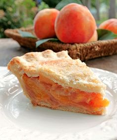 The Perfect Peach Pie.The flavor of the fresh peaches is up front and delicious the pie isnt overly sweet which allows the peach flavor and natural sweetness to come shining through. This is indeed The Perfect Peach Pie! Peach Pie Recipes, Fruit Recipes, Sweet Recipes, Cooking Recipes, Just Desserts, Delicious Desserts, Yummy Food, Summer Pie, Kolaci I Torte