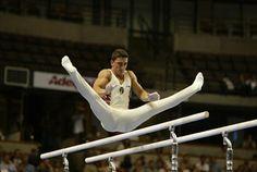 Amazing Gymnastics Photos: Marian Dragulescu (Romania) doing a straddle cut on parallel bars
