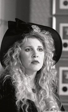 1990 - Stevie Nicks. I think she looks like a porcelain doll here.
