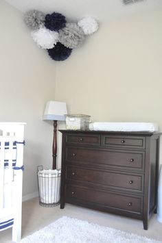 love the antique looking hamper and diaper basket.