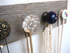 Take an old board and then screw in assorted knobs. Perfect for holding jewelry.