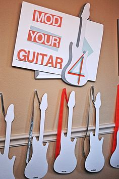 love this idea: guitar shapes for the guests to decorate, and also look fantastic as party decoration at a rock star party