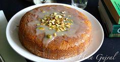 A delicious and simple recipe of eggless cardamom spiced pistachio semolina cake.