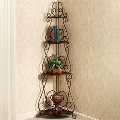 The Meyda Tapering Corner Etagere has four wooden shelves for display use. Furniture features metal banded scrolls finished in antique bronze with gold and copper highlights. Black Plant Stand, Plant Stands, Copper Highlights, Wooden Chandelier, Corner Wall, Victorian Decor, Do It Yourself Projects, Wooden Shelves, Metal Bands