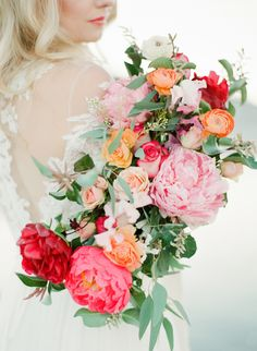 Stunning colorful + cascading wedding bouquet: Photography : Sophie Epton Photography Read More on SMP: http://www.stylemepretty.com/texas-weddings/johnson-city/2016/01/27/romantic-ethereal-pedernales-falls-inspiration-session/
