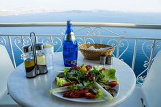 Sitting at a beautiful dinner table with a lovely Greek dish watching the sun go down. Can it get any better? :)  https://theislandofrhodes.com/customs-and-culture-in-greece-the-food