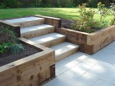 Sleeper retaining walls and pavior capped steps landscaping Garden stairs, Sloped garden Back Gardens, Outdoor Gardens, Small Gardens, Sleeper Retaining Wall, Retaining Wall With Steps, Wooden Retaining Wall, Garden Retaining Walls, Landscaping Retaining Walls, Retaining Wall Drainage