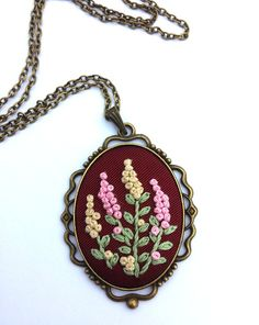 Fabric Embroidered Necklace, Pink and Ivory Flower Necklace, Boho Chic Jewelry  Vintage inspired large oval pendant necklace. Delicate embroidered pendant in antique style with colorful spring flower bouquet. • Embroidered piece is 30x40 mm (1.18x1.5) Leave a note at checkout for any custom length. Antiqued brass cable chain is closed with a lobster clasp (lead and nickel free).  Due to the nature of this product, it is best if you do not submerge in water.  My pictures are taken under…