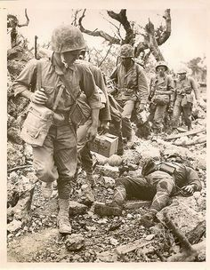 U.S.Soldiers Pass Dead Enemy Soldier. Pacific Theater.: