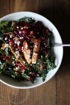Chili Chicken Kale Salad with Pecans, Shredded Beets, Goat Cheese, Pomegranate Seeds, and Cinnamon Dijon Vinaigrette