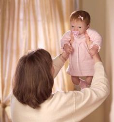 """Ashton Drake Celebration of Life Baby Emily Doll by Ashton Drake. $149.99. """"Emily"""" is a delightful So Truly Real® collectible vinyl baby doll, designed by renowned doll artist Linda Webb and available only from The Ashton-Drake Galleries. Satisfaction Guaranteed: Free Returns for 365 Days. This realistic baby doll is handcrafted of Ashton-Drake's RealTouch™ vinyl skin, with lifelike folds and creases. Certificate of Authenticity. Measures 22"""" long. Created by Master Doll Art..."""
