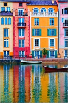 Houses in Portofino, Italy.  They are very bright and colorful.  Many of these have a balcony of the top floor