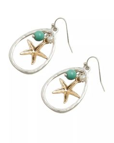 """Mixing gold and silver has become a fashion statement, rather than a fashion no-no. These Starfish Charm Earrings are a simple statement on their own, or a great pair for our other starfish inspired necklaces or bracelets. Brass with gold tone plating. Resin bead. Hook post closure. 1.25""""x .75"""". Lead compliant metal. Made in China."""