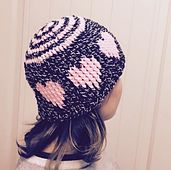 Want to make a special hat just in time for Valentines Day? This Heart Love Hat has heart design elements worked all around it. This is an easy crochet project that is worked entirely with front post double crochet stitches. There is plenty of material provided in the pattern to help you do simple and seamless colour changes outlined in the pattern such as a diagram, photos and a quick video.