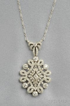 Art Deco Platinum and Diamond Pendant, France, set with old European- and single-cut diamonds, approx. total wt. 1.45 cts., completed by a fine link chain, lg. 1 1/2 and 16 in., maker's mark and guarantee stamps.