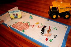 Act Out a Story by setting up a play scene for 'The Little Blue Truck'