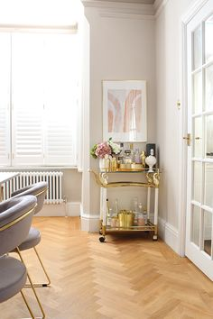 vintage bar cart with taupe walls and parquet flooring Room, Bar Furniture, Taupe Living Room, Taupe Walls, Bar Cart Decor, Home Decor Trends, Tiny Dining Rooms, Pink Dining Rooms, Taupe Dining Room