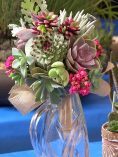 Succulent bridal bouquet and centerpiece ideas.  How awesome are these!