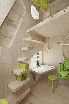 The desk is an open-able window. The steps are book shelves. The whole thing is in wood joinery and made of wood in 100 sqm Smart Student Flat – TimeForDeco