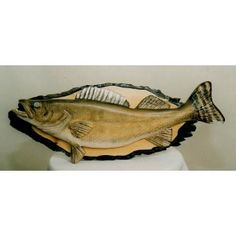 The weight of a gift depends on the choice of the giver! http://cottonwoodcovecrafts.com/categories/carved-wooden-fish