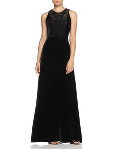 Fashion's crush on velvet takes Elie Tahari's plush gown to the top of your sartorial lust list. The glamorous number's beaded bib and floor-grazing silhouette deliver swoon-worthy style to your next