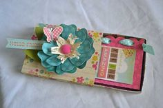 Cute box using paper from the Fabulous Collection by Simple Stories with a mini scrapbook inside.
