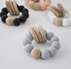Baby Rattles, Teething Ring, Baby Gift Ideas Our wood and silicone baby rattles are great gift ideas Boy Shower, Baby Shower Gifts, Baby Gifts, Minnie Mouse Cookies, Baby Diy Projects, Baby Teethers, Teething Toys, Baby Rattle, Baby Toys