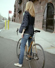 love the chic outfits when they match with a bicycle