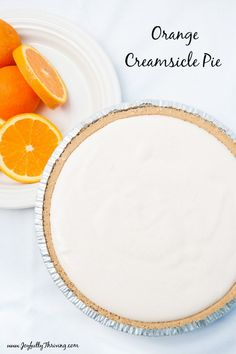 Yum! It's an easy freezer recipe that makes an orange creamsicle pie with only 5 ingredients! A great freezer dessert! #pie #freezercooking #creamsicle Freezer Desserts, Easy Freezer Meals, Freezer Cooking, Easy Cooking, Easy Desserts, Delicious Desserts, Dessert Recipes, Sweet Desserts, Creamsicle Pie Recipe