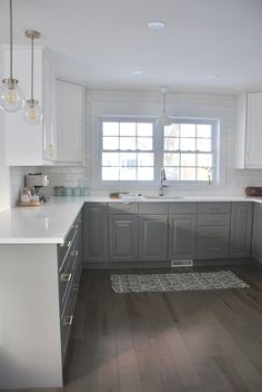 the colors of the lower cabinets and wood floor seem right. seems a little bland without black framed windows, other minor black details like trim on lighting, and other light oak wood accents in accessories - the white may be too white.... and i may prefer the lower and upper cabinetry to be the same color
