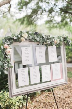 Wedding Seating Chart. Mirror, florals, greenery