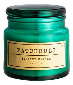 Dark green/patchouli. Small, scented wax and paraffin candle in a glass holder…