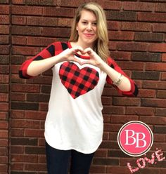 Love is in the air @brandisboutiqueshop!! LOTS of festive Valentine's Day wear has arrived & more is on the way! • Pictured: Plaid Raglan Heart Breaker Tunic ($24.95) #BBGirls #valentines #heart #plaid www.brandisboutiqueshop.co > Ladies > Tops & Tunics ❤️