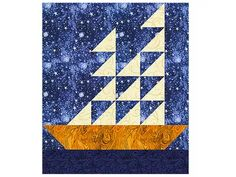 """Use my easy Sailboat Log Cabin quilt block pattern to sew a batch of quilt blocks that finish at 12"""" x 12""""."""