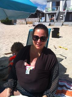 From Renee: I NEED my first wrap...and inspiration! I'm overwhelmed, but inspired. Here I am this weekend with a borrowed Moby. My two-year old is behind me and my five-week old boy/girl twins are BOTH wrapped. Chasing the elder on the beach was exhausting and this wrap was too hot! Please help me!