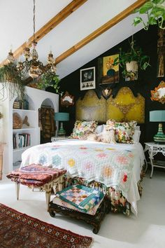 "When it came to the master bedroom, it was all about the hunt. Aldridge scored big at a Savannah estate sale, where she found vintage drapes, and later uncovered the unbelievable Capodimonte porcelain chandelier at a garage sale. The twin wood-and-papier-mâché headboards, which Aldridge snapped up from a local dealer, are pushed together to form one piece long enough for her king bed. ""The wall is black; it was a spur-of-the-moment decision,"" says Aldridge. ""I love it because it makes the…"