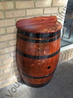 Half wine barrel table.   Built from a retired wine barrel cut in half.  Has a pine table and back board mounted to the top of it.  Bar table is painted with jarrah stain & varnish.  Great for a bar table in small areas.   http://voughtwoodenfurniture.id.au/wine-barrel-bar-tables/4580541605