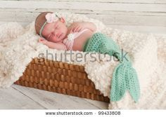 Sooo adorable! Google Image Result for http://image.shutterstock.com/display_pic_with_logo/666442/99433808/stock-photo--week-old-newborn-girl-wearing-a-crocheted-mermaid-costume-sleeping-in-a-basket-with-a-bleached-99433808.jpg