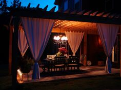 The curtains and lighting make this the perfect backyard escape. .... Outdoor Dining Pergola, We added a 12x18 pergola covered patio off of our indoor dining room so we can enjoy the garden while eating! The second pergola is down in the garden away from the house. I just posted pics of that one too!, Patios & Decks Design