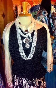 Popcorn Top-does not wrinkle fits most sizes-flattering and elegant $16.95. Scarf/Necklace available in a variety of colors $14.95 Satin Skirt Worn together or sold separately #fredericksburgtx #wildseedfarms